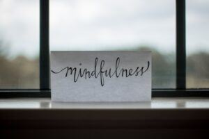 Mindfulness Word in A Printed Paper near to Window